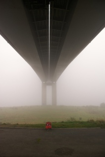 My kids under Foyle Bridge on a typically foggy day